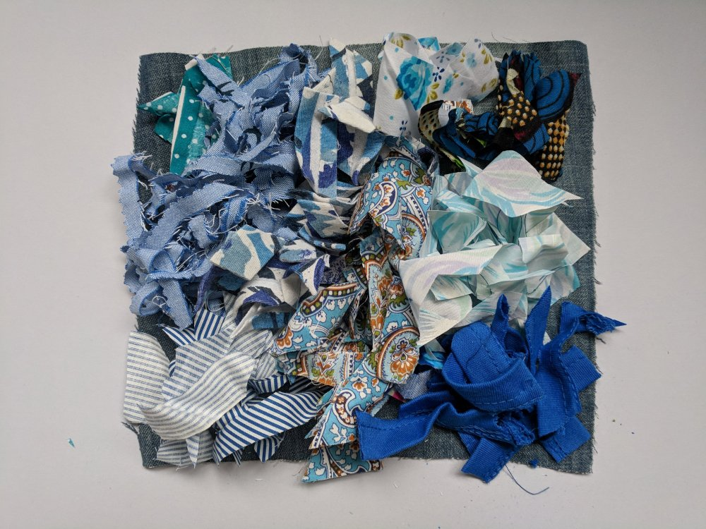 Blue scraps laid on their base layer
