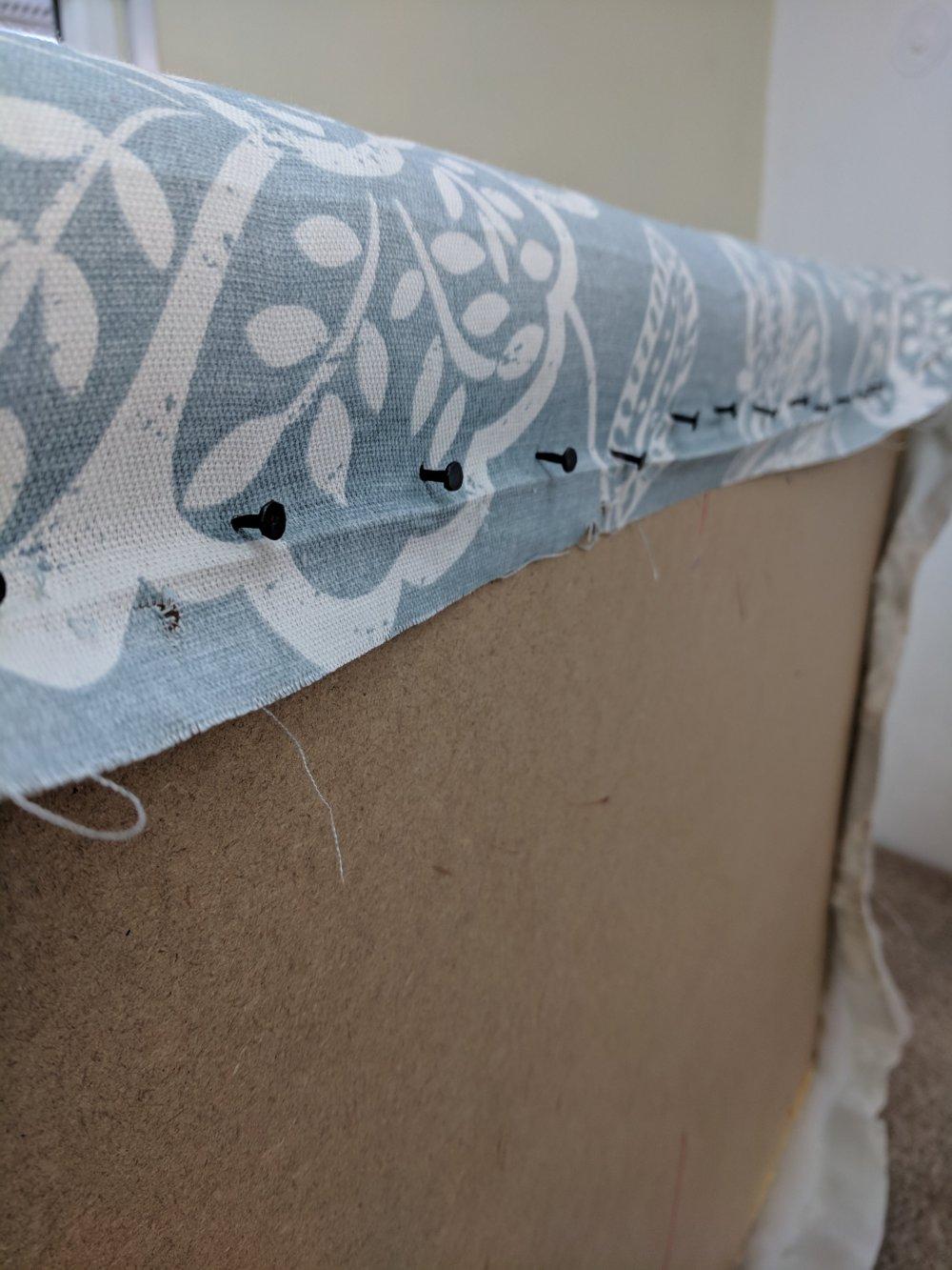 Close up of tacked edge