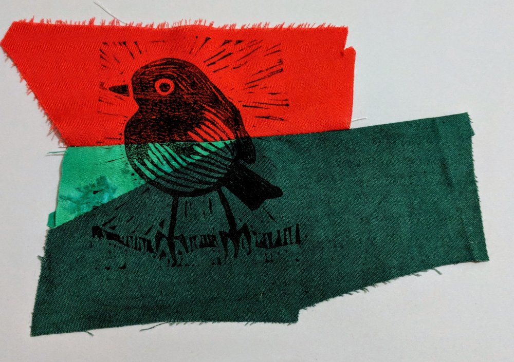 Lino printed robin on patched fabrics