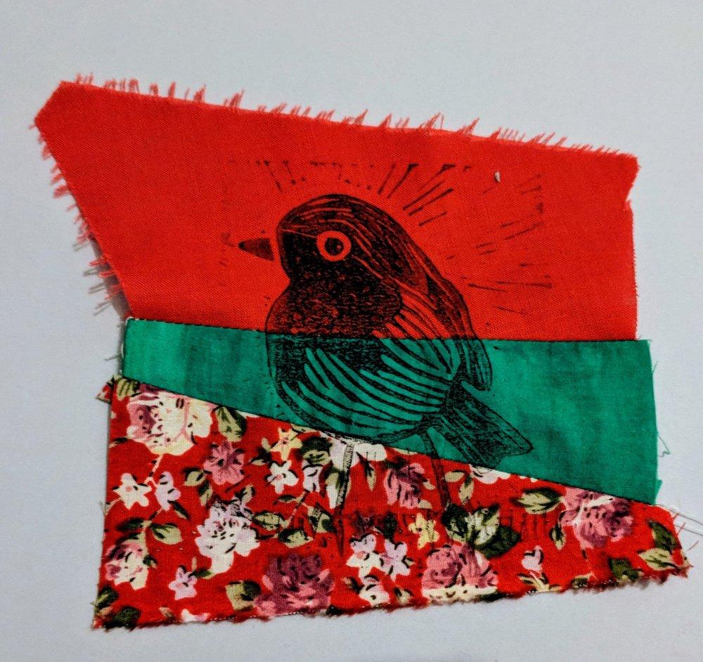 Lino printed robin on fabric scraps