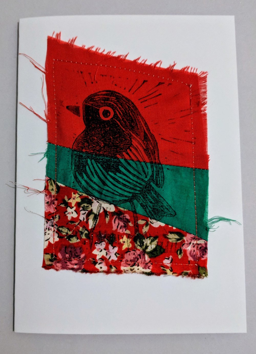 Robin print stitched onto a card